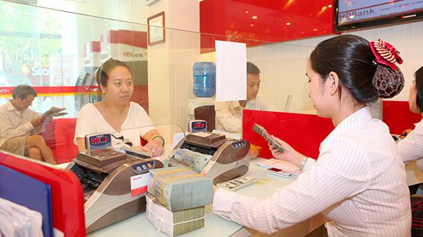 Thống đốc Lê Minh Hưng điểm lại, năm nay thị trường ngoại tệ và tỷ giá ổn định đã củng cố lòng tin vào đồng tiền Việt Nam. Ảnh: Tường Lâm