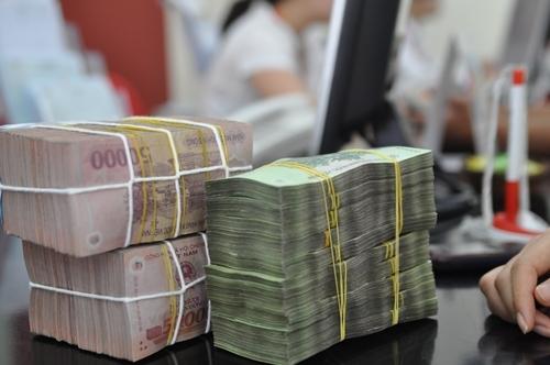 Nam 2016, dong Viet Nam mat gia 1,1-1,2%